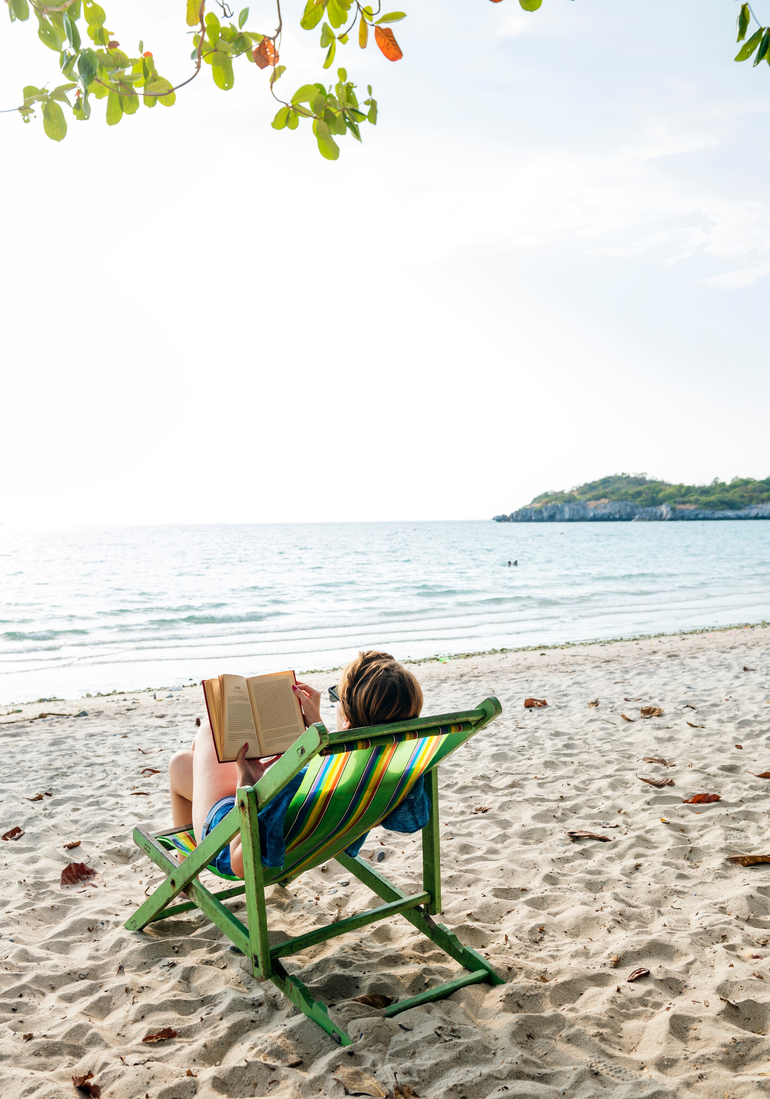 book reading on the beach rawpixel unsplash