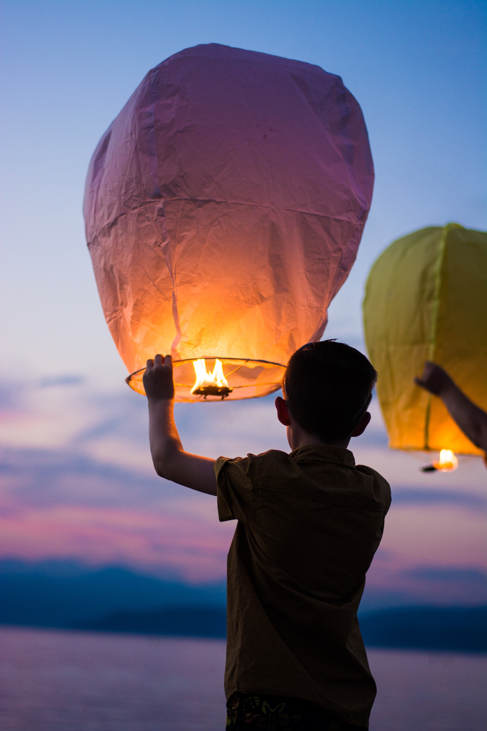 gianandrea villa children light lanterns unsplash